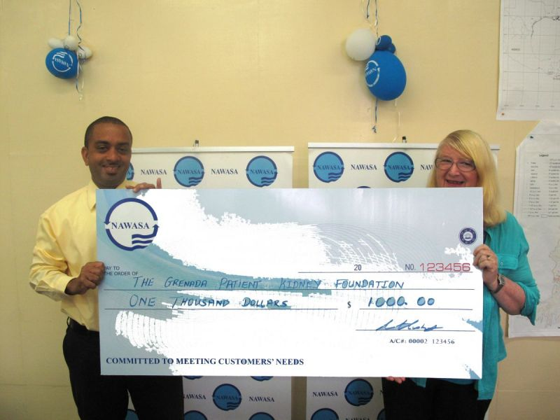 General-Manager-Christopher-Husbands-makes-cheque-presentation-to-Mrs-Heather-Sylvester-from-the-Grenada-Kidney-Patient-Foundation-revised