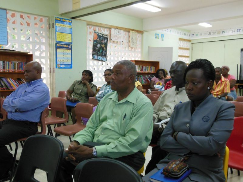 Persons-at-community-meeting-including-CSU-Representative-Ms-Dorcas-Swan-and-Asset-Protection-Supervisor-Mr-Roy-Raymond
